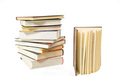 Pile of books. And one open book on white background Royalty Free Stock Photos
