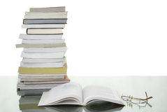 Pile of books with one opened Stock Images