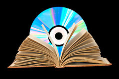 Pile of books, open book,  and DVD Royalty Free Stock Photo