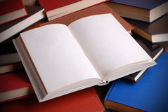 Pile of books. Open book with empty pages stock images