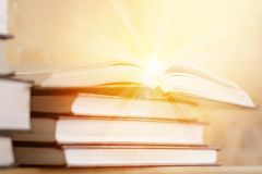 Pile Of Books With Open Book Rays Light The Concept Royalty Free