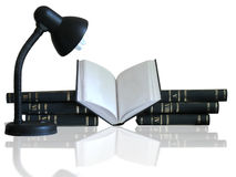 Pile of books, opened book and lamp. Pile of books, opened book and a lamp isolated on white background with reflection royalty free stock photography