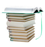 Pile of the books, openning book up. Pile of the books on white background, openning book with green bookmark Stock Photography