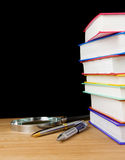 Pile of books and pen on black Royalty Free Stock Image