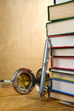 Pile of books and pens on wood Royalty Free Stock Photo
