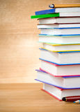 Pile of books and pens on wood background Stock Image