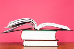 Pile of books on pink background Royalty Free Stock Photos