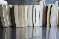 A pile of books put on a desk. Stock Images