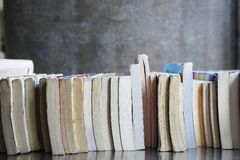 A pile of books put on a desk. Royalty Free Stock Photos