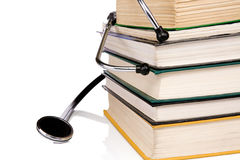Pile of books and stethoscope isolated on white Royalty Free Stock Images