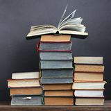 Pile of books on a table. Education, back to school. Stock Photos