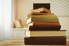 Pile of books on table. In the room royalty free stock images