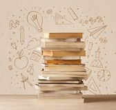 A pile of books on table with school hand drawn doodle sketches Stock Photo