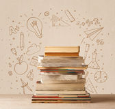 A pile of books on table with school hand drawn doodle sketches Stock Photography