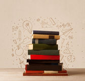 A pile of books on table with school hand drawn doodle sketches Stock Image