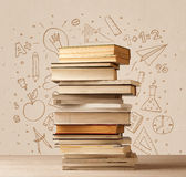 A pile of books on table with school hand drawn doodle sketches Royalty Free Stock Images