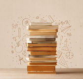 A pile of books on table with school hand drawn doodle sketches Stock Images