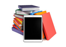 Pile of books with a tablet, isolated on white background Stock Photography