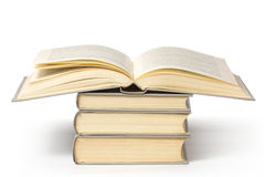 A pile of books, top one is open Royalty Free Stock Photography