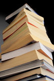 Pile of books. Tower  on black background Royalty Free Stock Photo