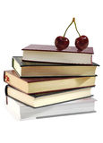 Pile of books and two sweet cherries. Royalty Free Stock Images