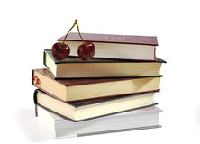 Pile of books and two sweet cherries. Royalty Free Stock Photography