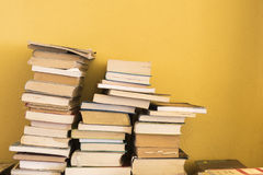 A pile of books. Before a wall Royalty Free Stock Image