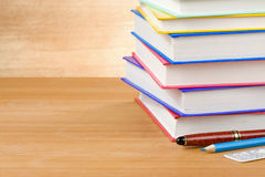 Pile of books on wood. Background Stock Photos