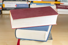 Pile of books on wooden desk Royalty Free Stock Photo