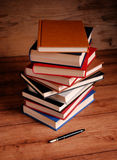 Pile of books. On wooden table stock photos
