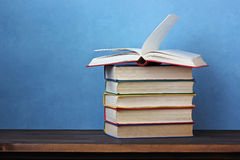 Pile of books on a wooden table. Stock Photo