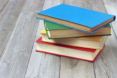 Pile of books on a wooden table. Education, back to school. Royalty Free Stock Images