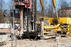 Pile bore machine. A pile driver is a mechanical device used to drive piles, poles into soil to provide foundation support for buildings royalty free stock images