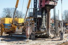 Pile bore machine. A pile driver is a mechanical device used to drive piles, poles into soil to provide foundation support for buildings stock image
