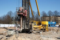 Pile bore machine. A pile driver is a mechanical device used to drive piles, poles into soil to provide foundation support for buildings stock photos