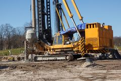 Pile bore machine. A pile driver is a mechanical device used to drive piles, poles into soil to provide foundation support for buildings royalty free stock photo