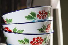 Pile of bowl decorated with painted flowers Royalty Free Stock Images