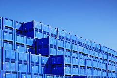 Pile of boxes containers. Pile of boxes or containers, storage under blue sky stock images