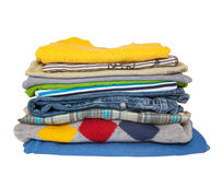 Pile of boys clothes isolated on white background stock image