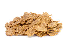 Pile of bran flakes. Over white background Stock Photos
