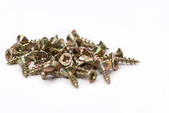 Pile of brass wood screws. Many brass wood screws  on a white background Stock Photography