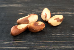 Pile of Brazil nuts. Some fresh Brazil nuts on wooden background stock image