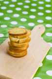 Pile of bread toasts on the wooden board Stock Photography