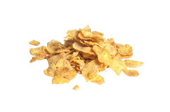 Pile of breakfast corn flakes, isolated. On the white background Royalty Free Stock Image