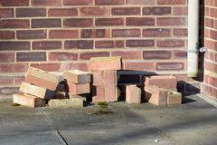 Pile of bricks from broken wall Stock Images