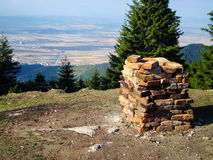 Pile of Bricks on Mountain Top. A pile of bricks on a mountain top with a view Stock Images