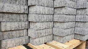 Pile of bricks on pallet stock photography