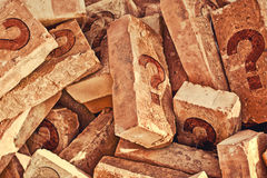 Pile of bricks with question marks Royalty Free Stock Image