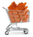 Pile of bricks in shopping cart Royalty Free Stock Images