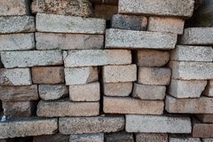 A pile of bricks. Warehouse building materials. Fragment of bricks used as building materials stock photography